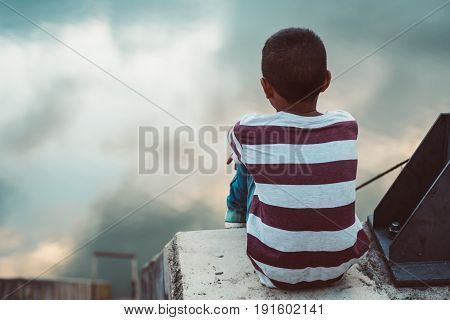 Young asian boy stay alone in the park