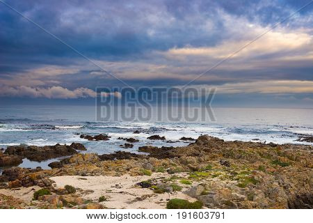 Rocky Coast Line On The Ocean At De Kelders, South Africa, Famous For Whale Watching. Winter Season,