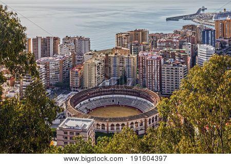 Malaga city, Spain. Bullring and harbor view.