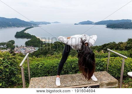 Woman upside down for viewing Amanohashidate in Kyoto