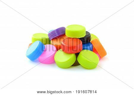 pile of colorful plastic bottle cap isolated on white background