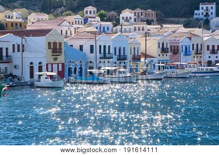 Greek style architecture in a picturesue town and seaport on the greek island Kastellorizo at the mediterranean coast in a picturesque view across the water.