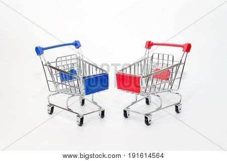 mini red and blue color supermarket shopping cart on white background holiday sale and online shopping concept selective focus copy space