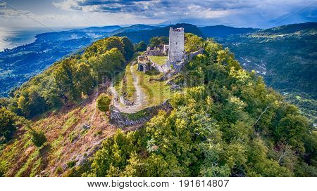 Ancient fortress with the remnants of the ruins on top of a mountain in New Athos Abkhazia