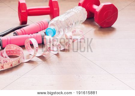 Measuring-tape and sport equipments for beauty woman Healthy and Diet concept