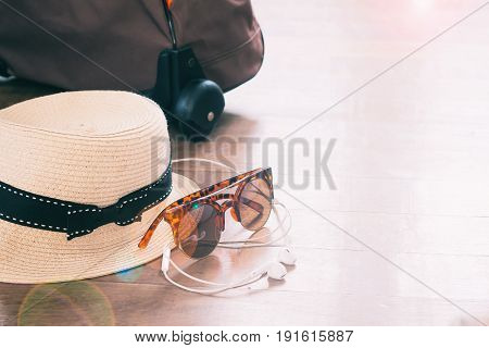 Lifestyle and travel items on wooden floor