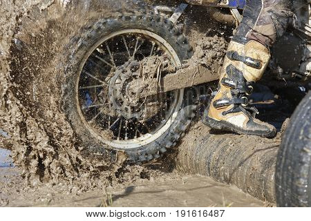 Racing  enduro dirt  wheel in muddy track.