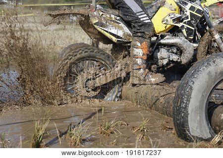 Racing enduro  dirt wheel in muddy track