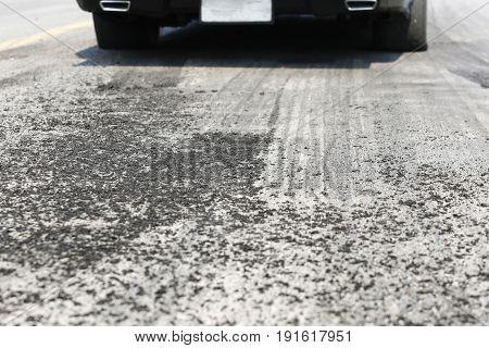 Tyre burnout marks on asphalt road .