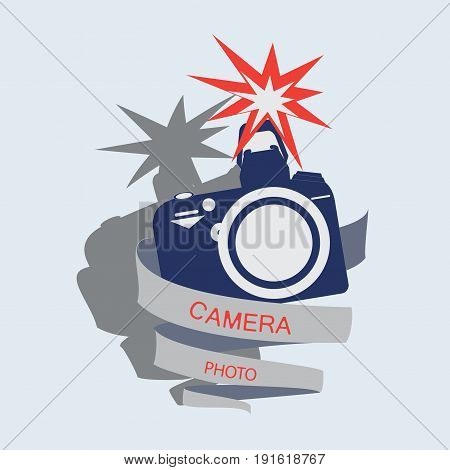 Camera with flash and a ribbon with the words Camera, photo. Emblem, label, icon. Vector image for photogate, makers, design themed website.