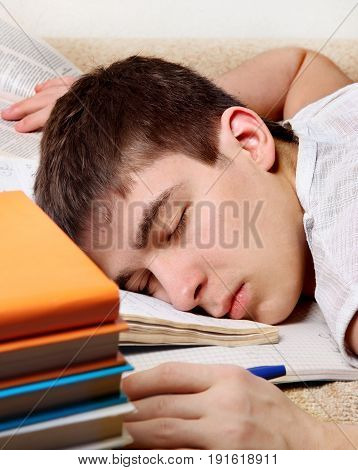 Tired Teenager sleep on the Couch with the Books