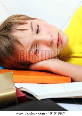 Sad and Tired Kid with the Books on the Bed