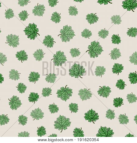 Restrained seamless floral pattern. Green leaves of maple on beige background can be used for design of textile print wrapping paper or computer wallpaper. Spring summer or autumn backdrop