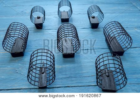 Black Fishing Troughs Made Of Iron. Decorative Background.