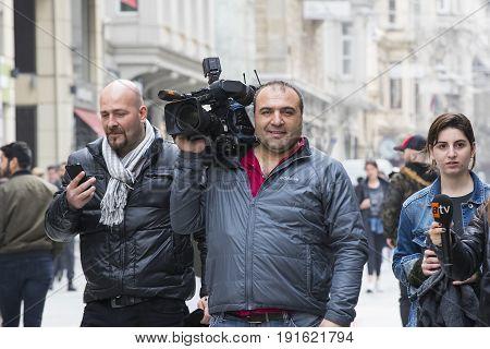 ISTANBUL, TURKEY - 4 APRIL 2017: Camera operator with camera in Istiklal Street, Turkey