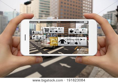 Augmented reality in marketing. Phone in hand on screen information guide about shopping and entertainment spaces in real time
