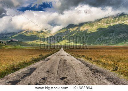Piano Grande di Castelluccio di Norcia (Perugia Umbria Italy) famous plateau in the natural park of Monti Sibillini: the road