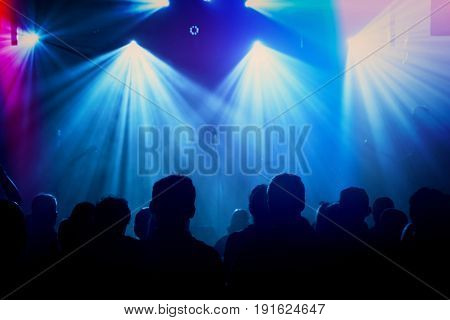 Rock band silhouettes on stage at concert. Abstract image.