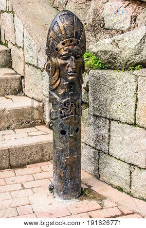 Incas shaped head, drinking water fountain in Agua Calientes, Cusco, Peru