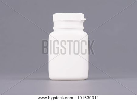 Blank big size medicine white plastic packaging bottles for cosmetics, vitamins, pills or capsules.