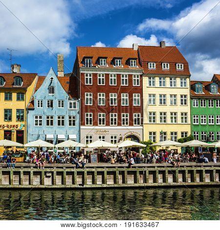 Save Download Preview Copenhagen, Denmark - May 3, 2016: Seafront Nyhavn in the old center of Copenhagen