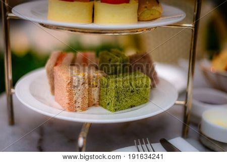 three tier afternoon tea set and pastries poster