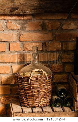 Wine cellar interior with old round flask