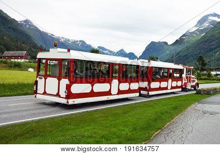 Olden, Norway - June 23, 2017: Tour bus in town Olden, Norway