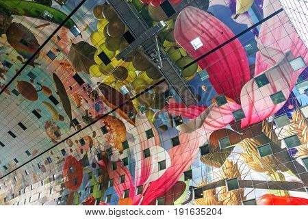 ROTTERDAM, THE NETHERLANDS - MAY 12 2017: Colorful ceiling decoration of the new Market Hall located in the Blaak district Rotterdam The Netherlands