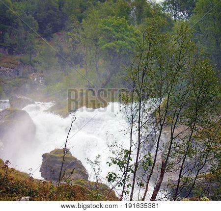 Spring water stream mountain river Briksdal, Norway. Norwegian landscape in national park Jostedalsbreen.