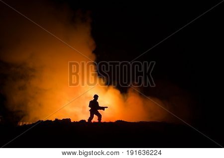 War Concept. Military silhouettes fighting scene on war fog sky background World War Soldiers Silhouettes Below Cloudy Skyline At night. Attack scene. Armored vehicles. Tanks battle. Decoration