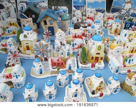 Greek style white and blue churches and houses, souvenirs for sale at Oia village on Santorini island of Greece