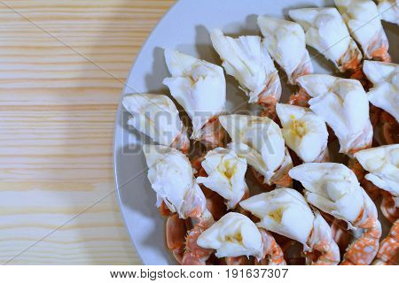 Top View of Steamed Flower Crab Legs Served on Wooden Table