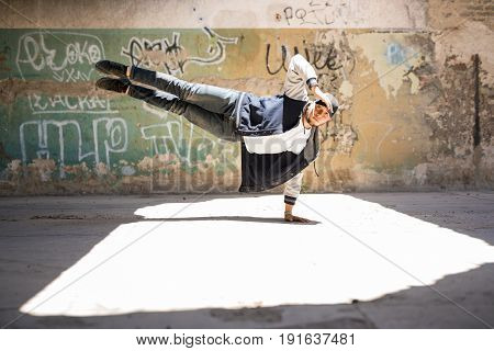 Male Dancer Doing A Handstand