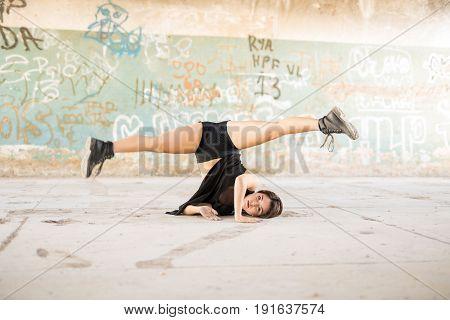 Female Dancer Doing A Leg Split
