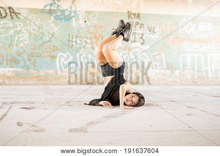 Pretty Dancer Doing A Headstand