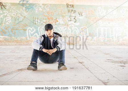 Hip Hop Dancer Sitting Outdoors