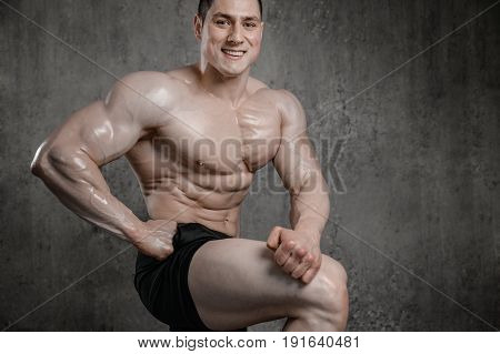Brutal strong athletic men pumping up muscles workout bodybuilding concept grey background - muscular bodybuilder handsome men doing exercises in gym naked torso fitness and bodybuilding workout bodybuilding concept background - muscular bodybuilder hands poster