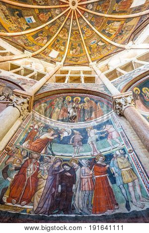 Parma, Italy - November 28, 2013: Frescoes, paintings and sculpture in the baptistery of the basilica cathedral