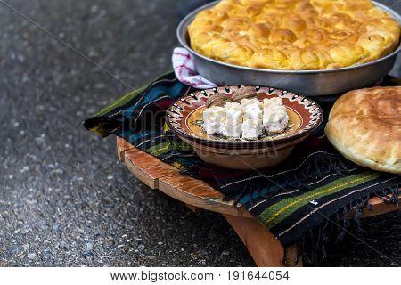 Traditional Bulgarian table - bread banitza/banica/banitsa cheese