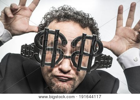 Fun Businessman with glasses in the form of silver dollar, expressions of surprise nerves, stress and power