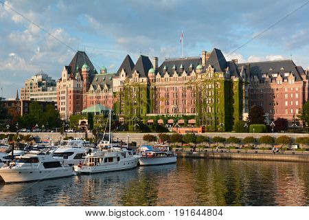 Victoria BC,Canada,May 15th 2014.The iconic Empress hotel in Victoria is a true Victorian landmark.Right across Victoria's famous inner harbor and close to downtown and other interesting attractions.Come to Vancouver island and visit Victoria.