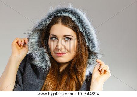 Happy Woman Wearing Dark Poncho Coat With Hood