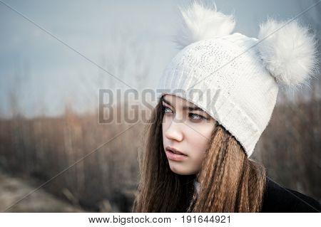 portrait beautiful teenage girl closeup in a white hat