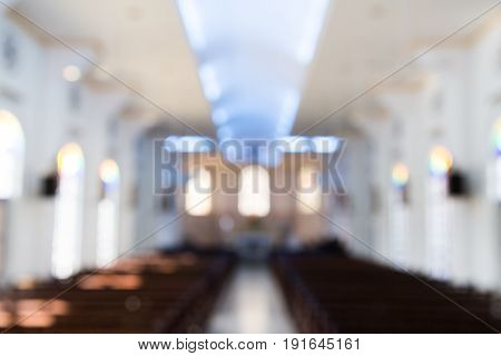 Defocused Interior Of Catholic Church With Pews
