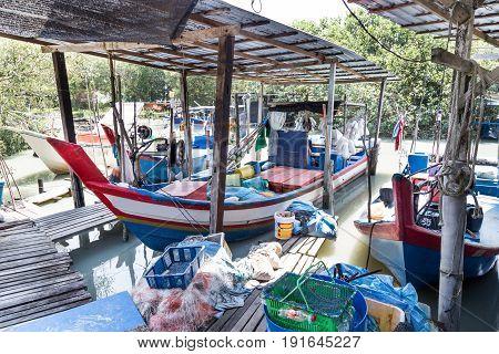 Traditional Fisherman Boat Trawler Berth On Small Jetty