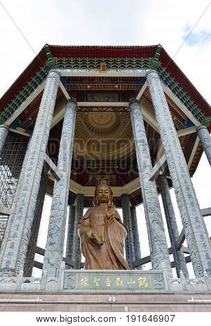 The statue of Guanyin or Goddess of Mercy at Chinese buddhist temple Penang Malaysia