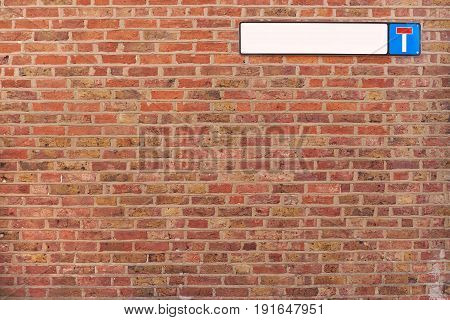 Brick wall background texture with cul-de-sac sign, good for graffiti