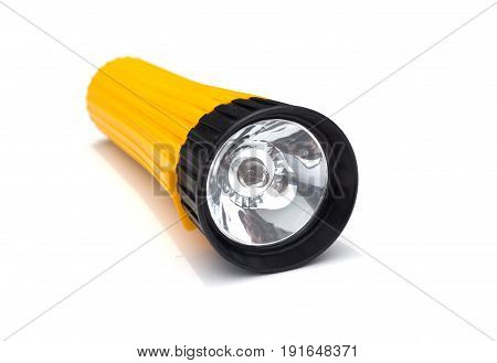 yellow electric flashlight with simple design isolated on white background. flashlight isolated