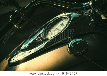 Solar glare on the dashboard on the shiny tank of a motorcycle.